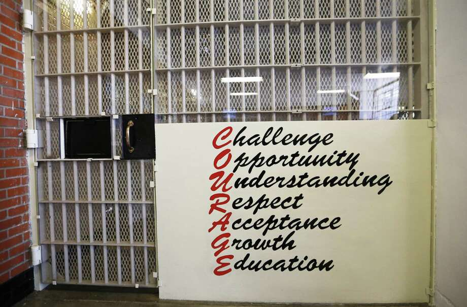 Encouragement is provided at an exit from inside the day room of the COURAGE Program at the O.B. Ellis Unit, a state prison in Huntsville, Texas. The youthful offender program will house up to 52 male offenders. Photo: Vernon Bryant, MBR / Associated Press / THE DALLAS MORNING NEWS