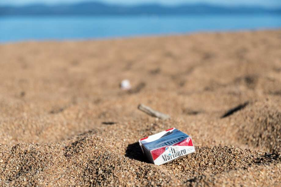Over 70 volunteers came together to pick up trash this Labor Day, September 4, 2018. In the piles of litter were 2,064 cigarette butts and 1,520 plastic straw.   This picture was taken during a similar July 5 event, that covered 6 miles of beach in South Lake Tahoe. Photo: Keep Tahoe Blue