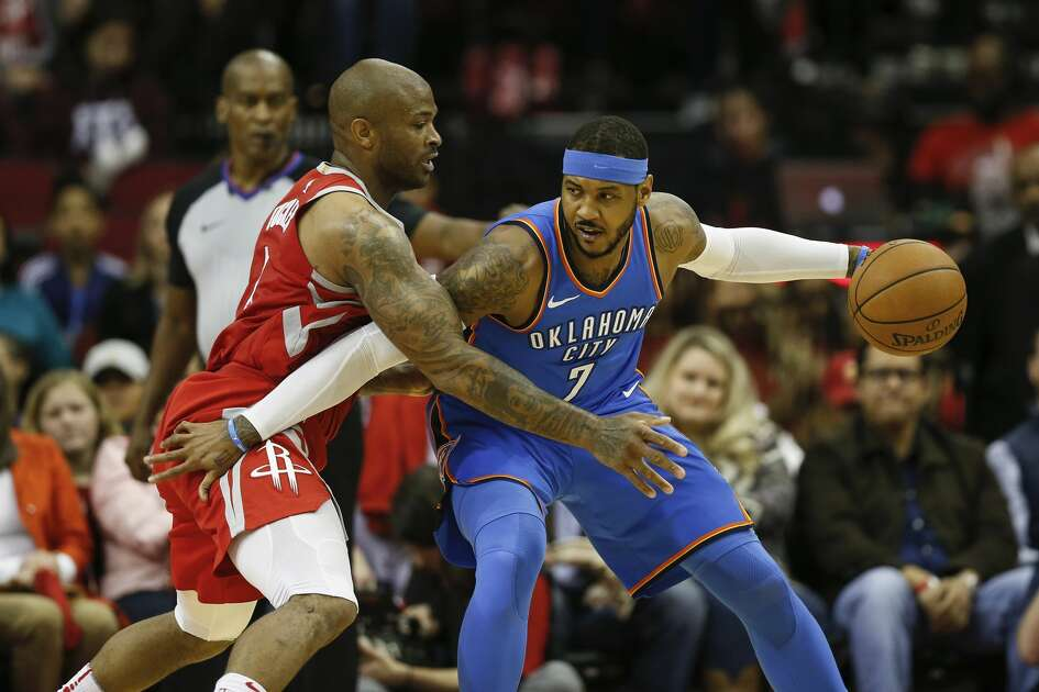 HOUSTON, TX - APRIL 07:  PJ Tucker #4 of the Houston Rockets defends Carmelo Anthony #7 of the Oklahoma City Thunder in the first half at Toyota Center on April 7, 2018 in Houston, Texas. (Photo by Tim Warner/Getty Images)