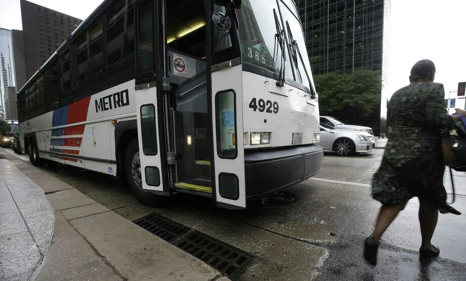 A Metropolitan Transit Authority bus stops at Louisiana and McKinney on July 11, 2017, in downtown Houston. Photo: Melissa Phillip, Staff / Houston Chronicle / © 2017 Houston Chronicle