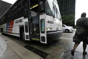 A Metropolitan Transit Authority bus stops at Louisiana and McKinney on July 11, 2017, in downtown Houston.