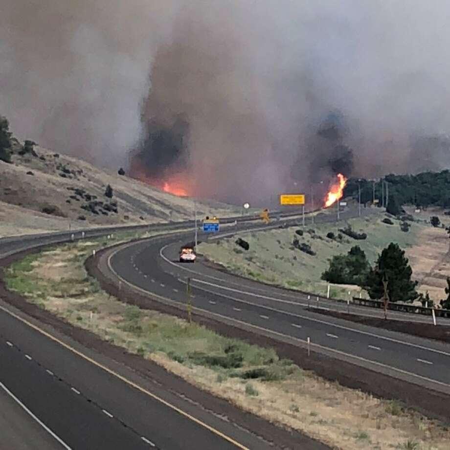 The Oregon Dept. of Transportation posted this photo of the Klamathon fire burning both sides of I-5 south of Hilt interchange. Photo: Twitter / @OregonDOT