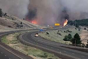 The Oregon Dept. of Transportation posted this photo of the Klamathon fire burning both sides of I-5 south of Hilt interchange.