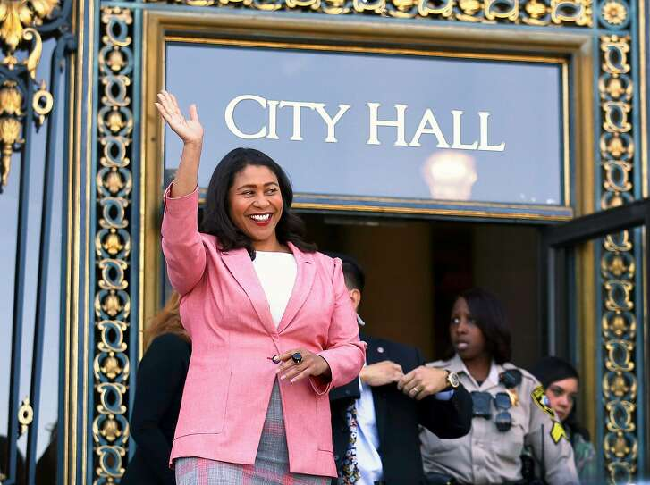 London Breed waves before speaking to reporters outside of City Hall in San Francisco, Wednesday, June 13, 2018. Breed was poised to become the first African-American woman to lead San Francisco following a hard-fought campaign when former state senator Mark Leno conceded and congratulated her Wednesday, more than a week after the election. (AP Photo/Lorin Eleni Gill)