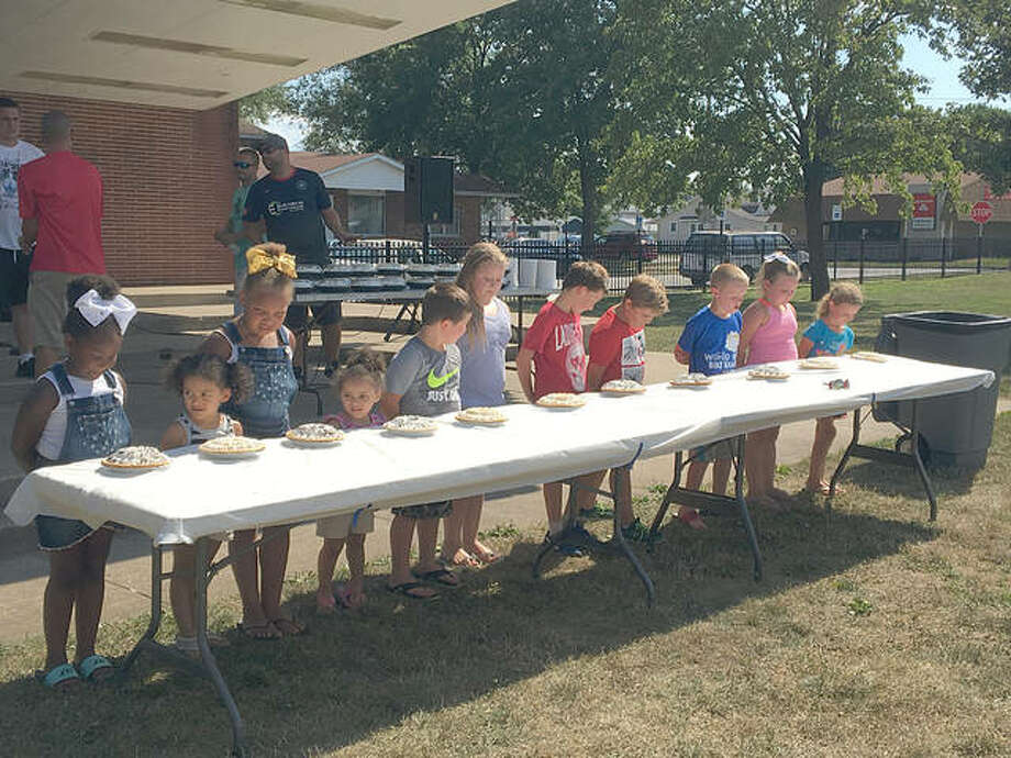 Participants in last year's pie-eating contest eagerly await the start of the competition. Photo:       For The Telegraph