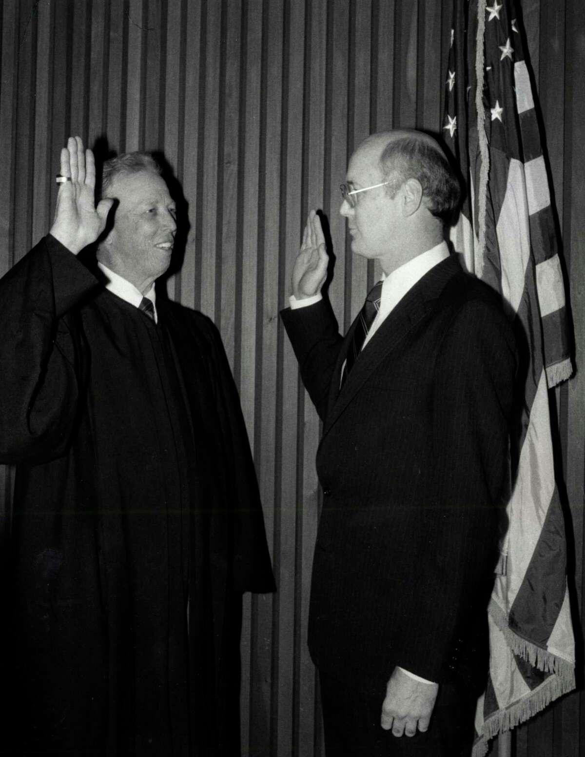 Former state District Judge Lynn N. Hughes, right, sworn in as a U.S. district judge by US District Judge John Singleton, left, Jan. 24, 1986.