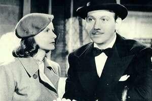 "Greta Garbo and Melvyn Douglas star in ""Ninotchka."""