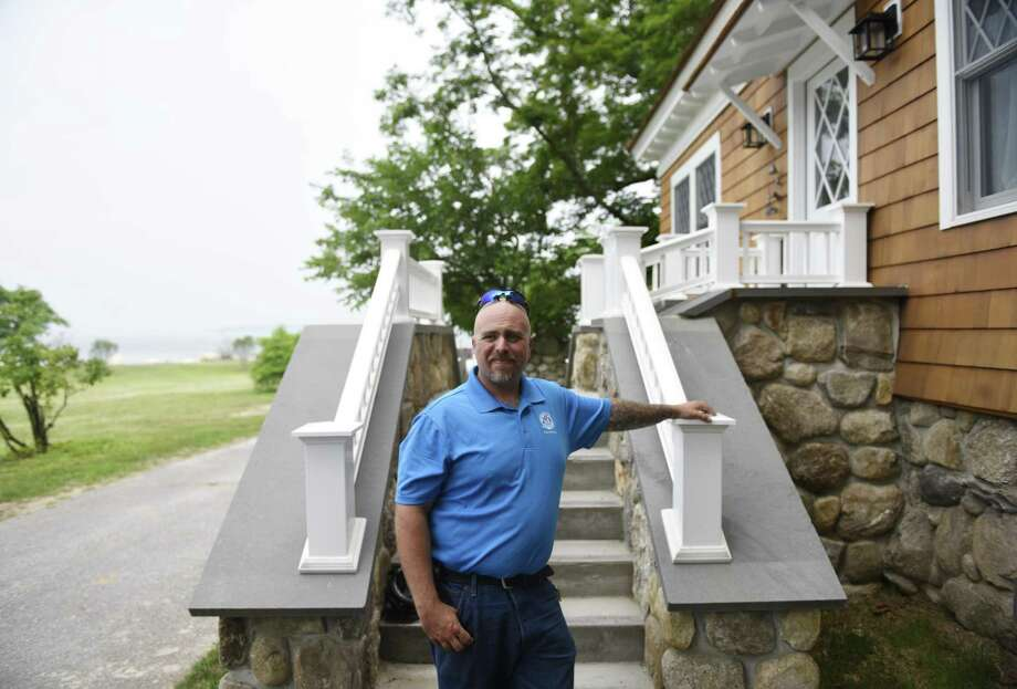 Greenwich Point Park caretaker Larry Imbrogno shows the live-in caretaker's cottage at Greenwich Point Park in Old Greenwich, Conn. Tuesday, July 3, 2018. Imbrogno recently moved in to the freshly-renovated cottage with his wife, Jennifer, and five-year-old twins Brayden and Tyler. Photo: Tyler Sizemore / Hearst Connecticut Media / Greenwich Time