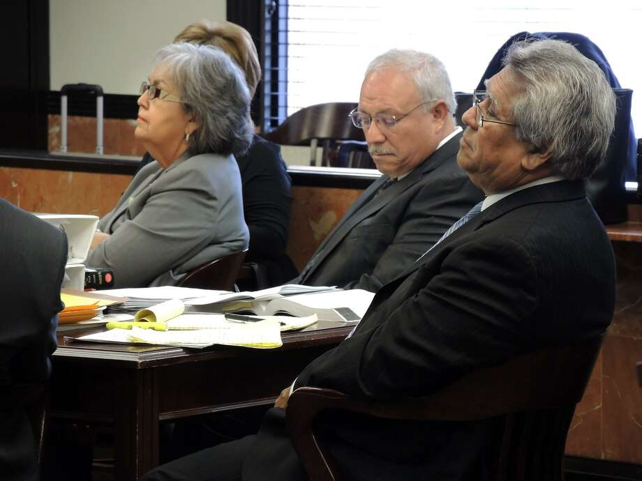 """Attorneys Maria Elena Morales, Armando Treviño (center) and Sergio """"Keko"""" Martinez listen to a hearing in state district court in Laredo in 2014. Treviño was charged in San Antonio recently with transporting two undocumented immigrants. Photo: Photo By Cuate Santos /Laredo Morning Times / LAREDO MORNING TIMES"""