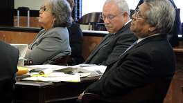 "Attorneys Maria Elena Morales, Armando Treviño (center) and Sergio ""Keko"" Martinez listen to a hearing in state district court in Laredo in 2014. Treviño was charged in San Antonio this week with transporting two undocumented immigrants."
