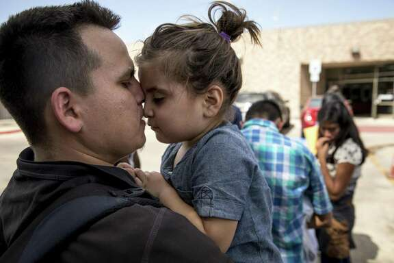 Onan, 27, carries his daughter Sofia, 3, from the bus station to the Catholic Charities of the Rio Grande Valley Respite Center after they were processed and released from detention in McAllen, Texas, July 3, 2018. Five days before the first government-imposed deadline to reunite migrant parents and children who were separated after crossing the Southwest border, immigration authorities are mounting a round-the-clock effort involving hundreds of federal workers to bring the families back together, a senior Trump administration official said Thursday. (Ilana Panich-Linsman/The New York Times)
