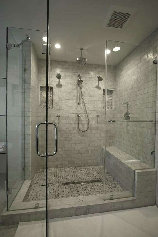 Frameless glass shower doors feature clear glass.
