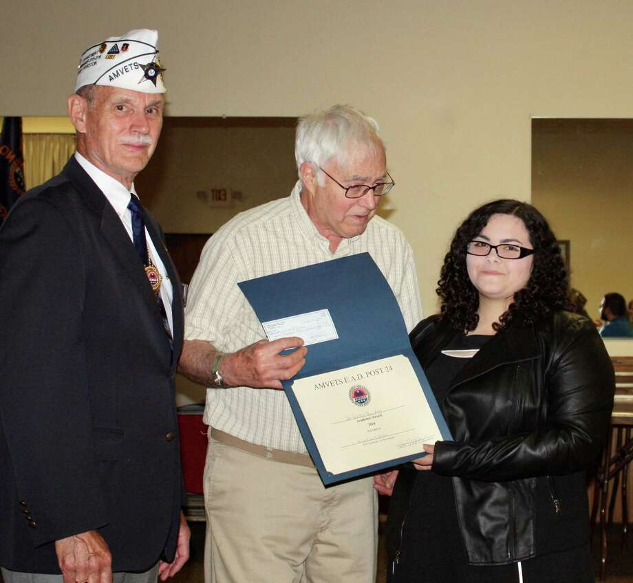 AMVETS EAD Post 24 of Northwest Connecticut in Torrington presented scholarships to local students on June 24. Above, Kristina Dileo receives her scholarship. Photo: Contributed Photo /