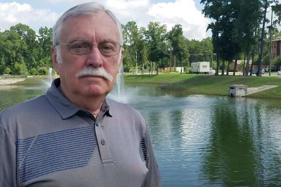 Thomas Stream, a longtime volunteer and resident of Kingwood, stands beside a lakeoutside Watercrest at Kingwood.