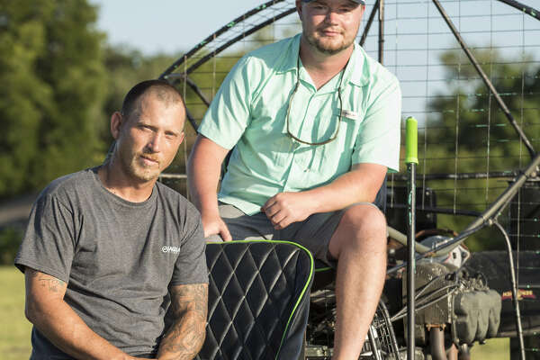 Kyle Schuenemann, left, and Chris George spent days helping people get out of floodwaters by airboat in the aftermath of Hurricane Harvey.