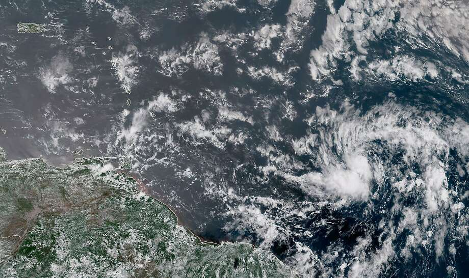 This image from the the National Oceanic and Atmospheric Administration (NOAA) shows Hurricane Beryl (lower right) on Saturday, July 7, 2018. Photo: JOSE ROMERO, AFP/Getty Images