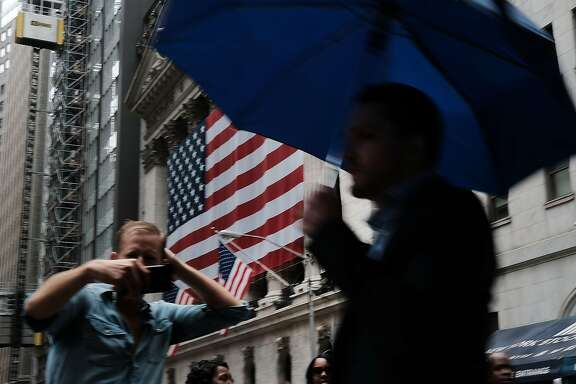 NEW YORK, NY - JULY 06:  People walk by the New York Stock Exchange (NYSE) on July 6, 2018 in New York City. After the U.S. levied tariffs on $34 billion worth of Chinese goods on Friday morning, China retaliated with tariffs on a similar amount of U.S. goods.  (Photo by Spencer Platt/Getty Images)