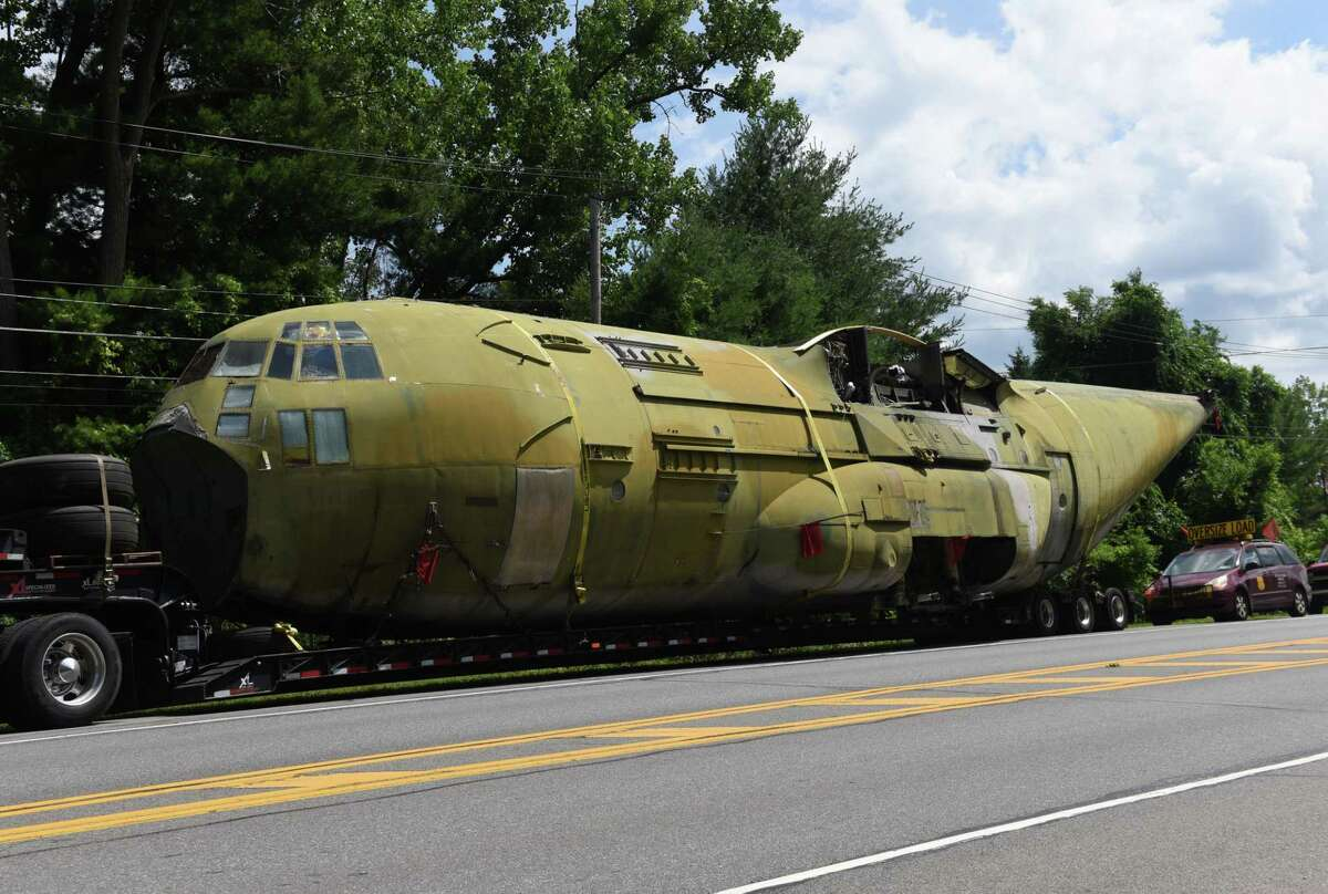 A Lockheed YMC130H, a highly modified version of the C130, is stopped on Route 155 during its transportation to the Empire State Aerosciences Museum on Friday, July 6, 2018, in Guilderland, N.Y. The plane is one of three aircraft modified in 1980 to attempt a second rescue mission of the American hostages at the embassy in Tehran, Iran. It was modified with added rockets boosters to assist in landing and takeoff. (Will Waldron/Times Union)