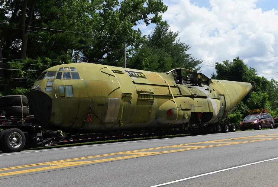 A Lockheed YMC130H, a highly modified version of the  C130, is stopped on Route 155 during its transportation to the Empire State Aerosciences Museum on Friday, July 6, 2018, in Guilderland, N.Y. The plane is one of three aircraft modified in 1980 to attempt a second rescue mission of the American hostages at the embassy in Tehran, Iran. It was modified with added rockets boosters to assist in landing and takeoff. (Will Waldron/Times Union) Photo: Will Waldron, Albany Times Union / 20044278A