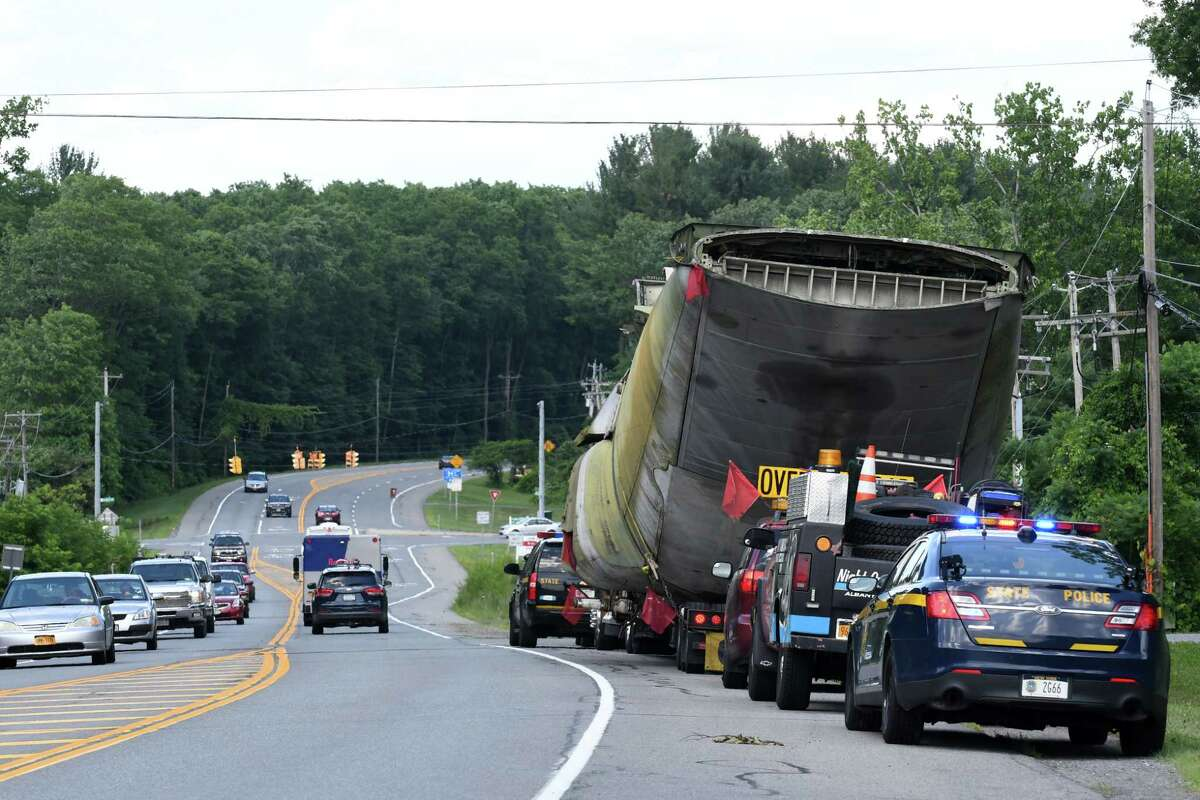 A Lockheed YMC130H, a highly modified version of the C130, stops on Route 155 during its transportation to the Empire State Aerosciences Museum on Friday, July 6, 2018, in Guilderland, N.Y. The plane is one of three aircraft modified in 1980 to attempt a second rescue mission of the American hostages at the embassy in Tehran, Iran. It was modified with added rockets boosters to assist in landing and takeoff. (Will Waldron/Times Union)