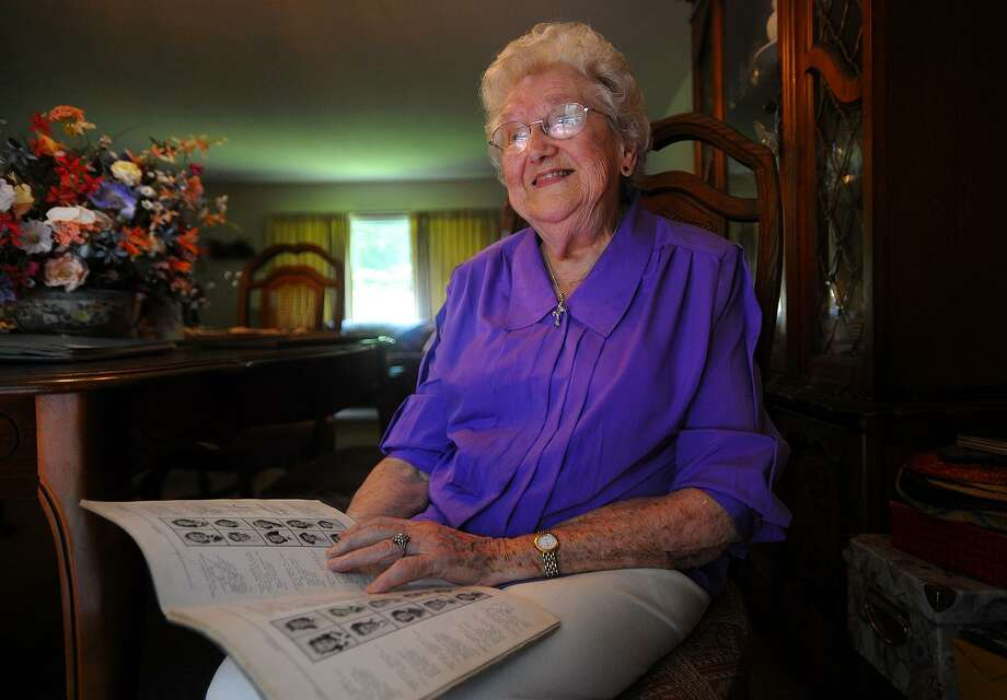 Anne Fiyalka, 97, looks over her 1939 Harding High School yearbook at her home in Easton as she recalls Amelia Earhart's visit to the school in 1936. Photo: Brian A. Pounds / Hearst Connecticut Media / Connecticut Post