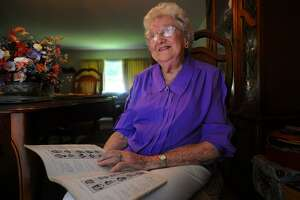 Anne Fiyalka, 97, looks over her 1939 Harding High School yearbook at her home in Easton as she recalls Amelia Earhart's visit to the school in 1936.