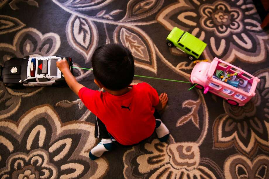 Jorgito, 5, plays with toys in the apartment he is staying in with his cousins in San Mateo County. Photo: Gabrielle Lurie / The Chronicle