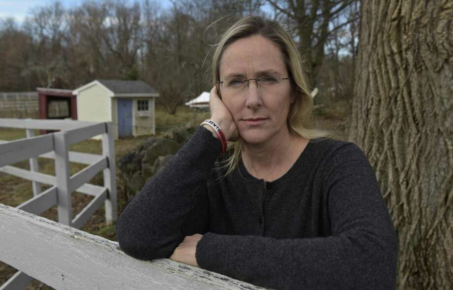 Scarlett Lewis stands in the yard of her Sandy Hook home in December 2017. Lewis lost her son, Jesse Lewis, in the Sandy Hook Elementary School shooting. Photo: H John Voorhees III / Hearst Connecticut Media / The News-Times