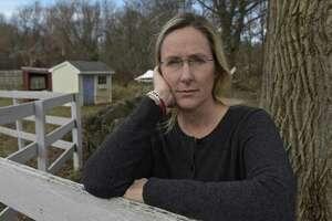 Scarlett Lewis stands in the yard of her Sandy Hook home in December 2017. Lewis lost her son, Jesse Lewis, in the Sandy Hook Elementary School shooting.