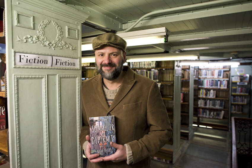 Nick Yetto, with a copy of his novel,