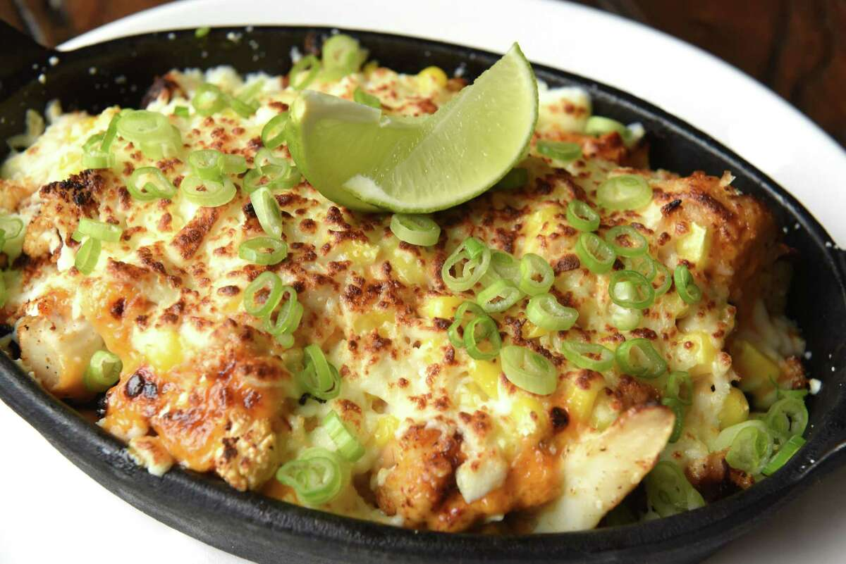 Mexican cauliflower appetizer: roasted cauliflower, queso fresco, chipolte mayo, grilled corn, lime, and chive at City Squire Ale House on Thursday, June 28, 2018 in Schenectady, N.Y. (Lori Van Buren/Times Union)