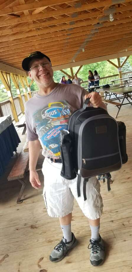 Scott Grupe displays his raffle prize during the Dymax annual picnic, held at at Boulder Ridge June 21. Photo: Deb Aleksinas / Contributed Photo