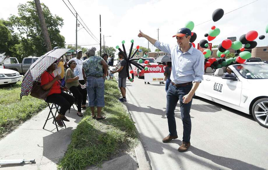 """Robert """"Beto"""" O'Rourke, running as the Democratic candidate for U.S. Senate waves to people as he made his way along the route   during the annual Juneteenth Parade in Acres Homes, Saturday, June 16, 2018, in Houston. ( Karen Warren  / Houston Chronicle ) Photo: Karen Warren, Staff / Houston Chronicle / © 2018 Houston Chronicle"""