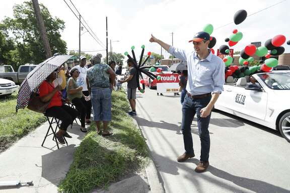 "Robert ""Beto"" O'Rourke, running as the Democratic candidate for U.S. Senate waves to people as he made his way along the route   during the annual Juneteenth Parade in Acres Homes, Saturday, June 16, 2018, in Houston. ( Karen Warren  / Houston Chronicle )"