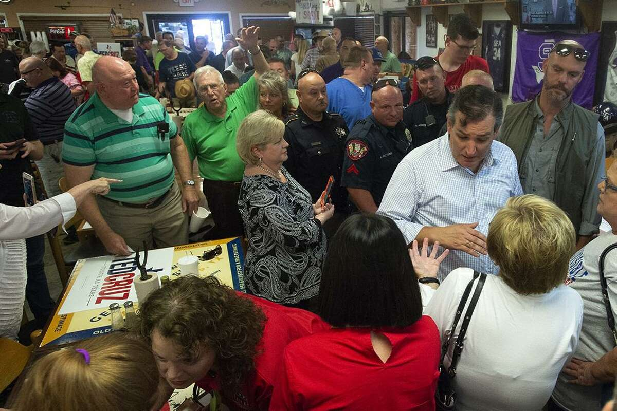 Constituents greet U.S. Senator Ted Cruz at the end of a campaign rally at CC's Smokehouse in Nacogdoches, Texas, on Friday, July 6, 2018. (Tim Monzingo/The Daily Sentinel via AP)