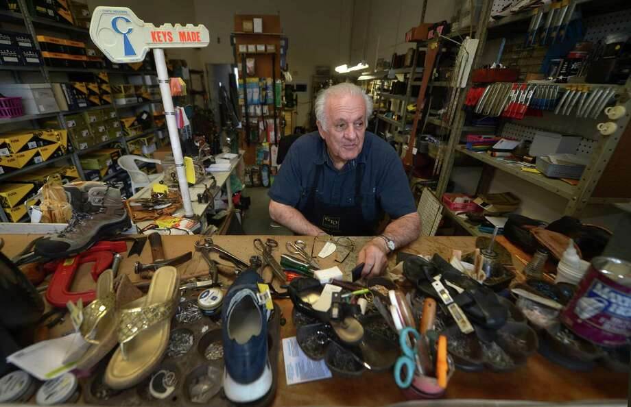 Economy Shoe Repair owner Joseph Ancona at His 82-year-old shop Wednesday, June 27, 2018, on Wall Street in Norwalk, Conn. Ancona has been uniquely impacted by the recent development in Norwalk. His 82-year-old business was moved from West Avenue by Waypointe and he had to move a second time from Butler Street when Waypointe began developing the parcel there. Now the parking lot behind his third resting place at 20 Wall Street may be scrapped for a third development. Photo: Erik Trautmann / Hearst Connecticut Media / Norwalk Hour