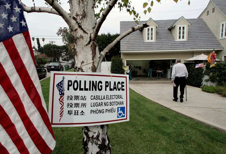 A man walks to his polling place in Los Angeles in November 2005. Photo: NICK UT / AP