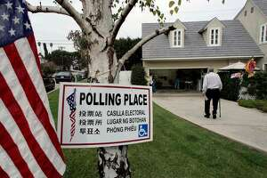 Richard Seaver walks to his polling place to cast his vote in the California special election Tuesday, Nov. 8, 2005, in Los Angeles. California voters go went to the polls Tuesday to decide the fate of Gov. Arnold Schwarzenegger's ballot proposals.    (AP Photo/Nick Ut)