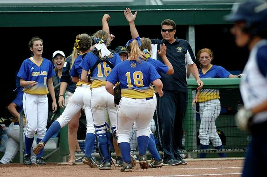 Former Midland High softball coach Robin Allen celebrates his Chemics' inning-ending double play against Macomb Dakota during a 2016 state semifinal at Michigan State University. (Daily News file photo) / Midland Daily News