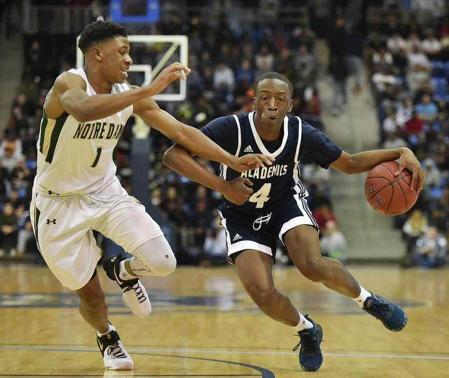 Hillhouse senior Tyler Douglas drives past Notre Dame junior Tim Dawson as the Acadmics oust the Green Knights, 70-62, for the SCC boys basketball championship, March 1, 2017, in front of a sold out crowd of 3,421- standing room only at TD Bank Sports Center at Quinnipiac University. Photo: Catherine Avalone / Hearst Connecticut Media File Photo / Catherine Avalone/New Haven Register