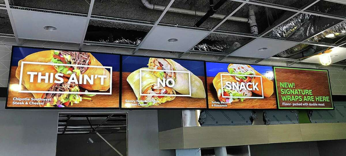 The Subway that recently opened in Brookfield Village features the restaurant chain's Fresh-Forward design, including a four-screen digital menu.