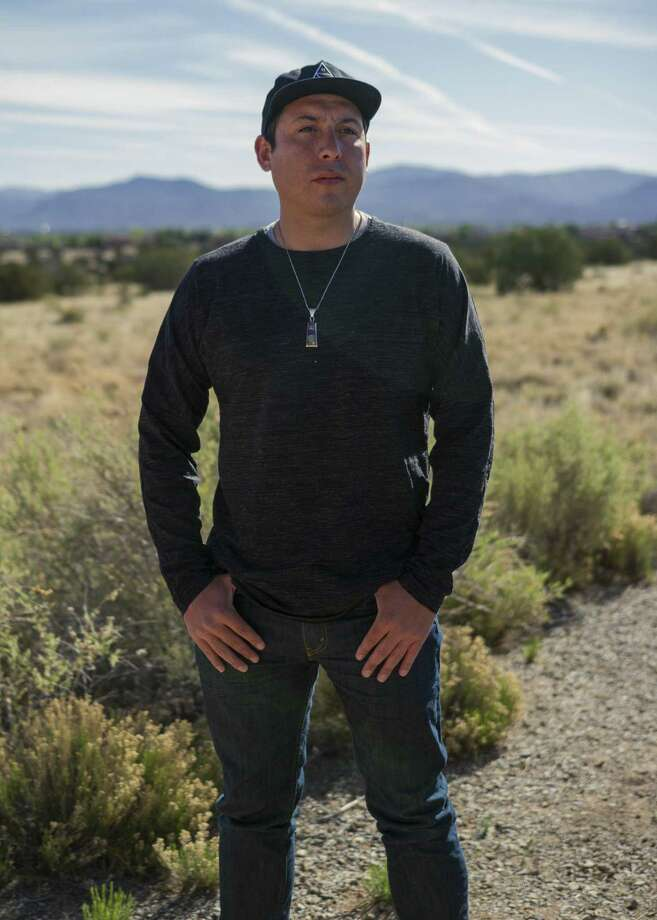"""Tommy Orange, the author of """"There There,"""" teaches at the Indian American Institute of Art in Santa Fe, N.M. For native people, Orange writes, cities and towns themselves represent the absence of a homeland a lost world of buried ancestral land, glass and concrete and wire and steel, unreturnable covered memory. There is no there there. Photo: CHRISTOPHER D. THOMPSON, STR / NYT / NYTNS"""