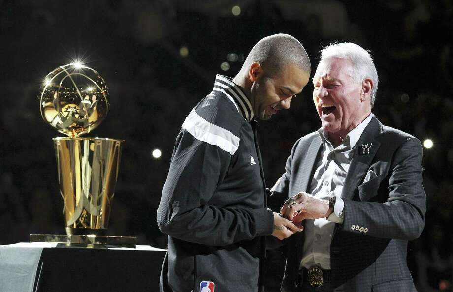 Spurs' Tony Parker receives his 2014 NBA Championship ring from team owner Peter Holt during the ring ceremony and season opener against the Dallas Mavericks at the AT&T Center on Tuesday, Oct. 28, 2014. (Kin Man Hui/San Antonio Express-News) Photo: Kin Man Hui, Staff / San Antonio Express-News / ©2014 San Antonio Express-News