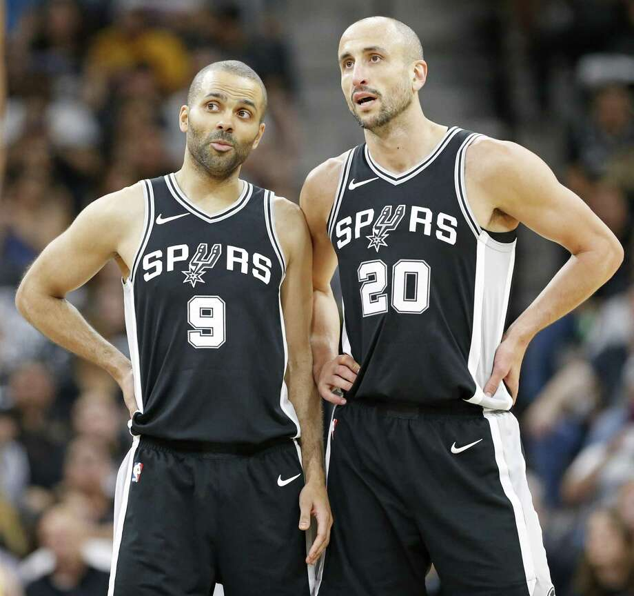 San Antonio Spurs guard Tony Parker (9) talks with guard Manu Ginobili (20) during first half action of Game 4 against the Golden State Warriors Sunday April 22, 2018 at the AT&T Center. Photo: Edward A. Ornelas, Staff / San Antonio Express-News / © 2018 San Antonio Express-News