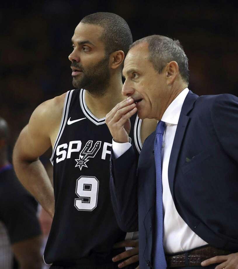 San Antonio Spurs acting coach Ettore Messina, right, speaks with Tony Parker during the first quarter in Game 5 of a first-round NBA basketball playoff series against the Golden State Warriors on Tuesday, April 24, 2018, in Oakland, Calif. (AP Photo/Ben Margot) Photo: Ben Margot, STF / Associated Press / Copyright 2018 The Associated Press. All rights reserved.