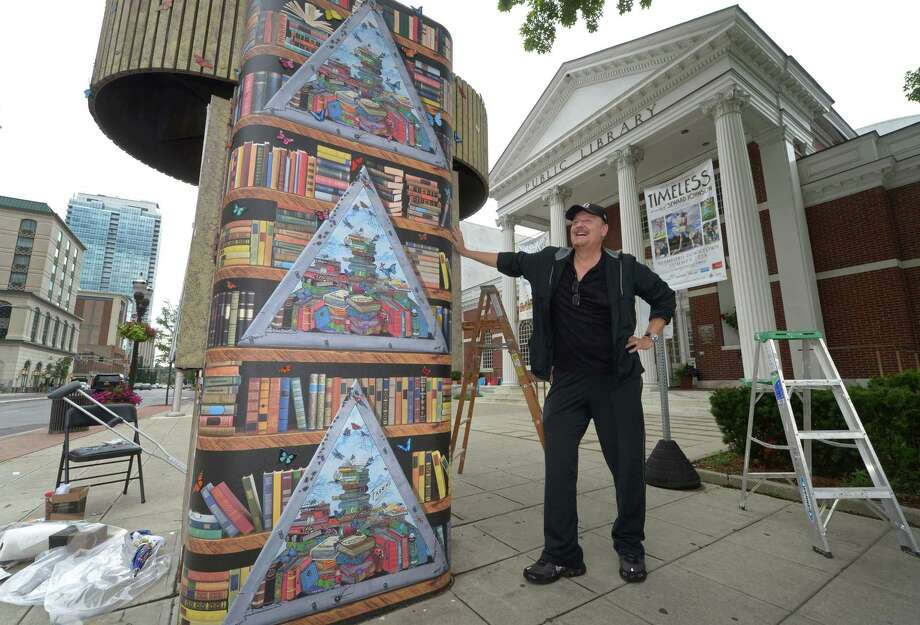 Charles Fazzino, International Master 3D Pop Artist, and his crew decorate the Kiosk structure at the Broad Street entrance of the Main branch of the Ferguson Library with butterflies as part of an art installation Friday, July 6, 2018, in Stamford, Conn. Photo: Erik Trautmann / Hearst Connecticut Media / Norwalk Hour