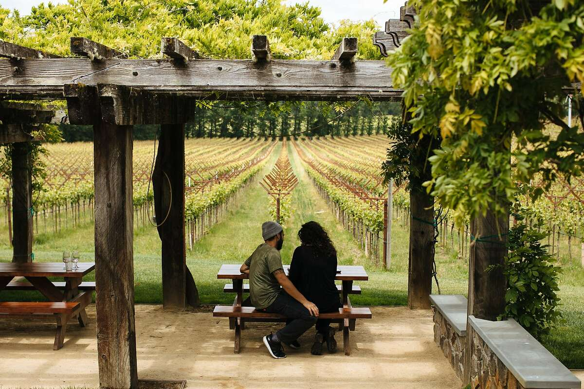 Is there anywhere you'd rather be with a glass of Gewurtz? Here, Travis Montemayor and Sara Villeda at Navarro Vineyards in Anderson Valley.