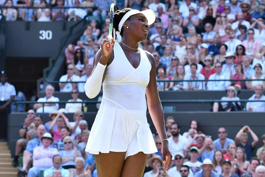 US player Venus Williams reacts after losing a point against Netherlands' Kiki Bertens during their women's singles third round match on the fifth day of the 2018 Wimbledon Championships at The All England Lawn Tennis Club in Wimbledon, southwest London, on July 6, 2018. Bertens won the match 6-2, 7-6, 8-6. / AFP PHOTO / Ben STANSALL / RESTRICTED TO EDITORIAL USEBEN STANSALL/AFP/Getty Images Photo: BEN STANSALL, AFP/Getty Images