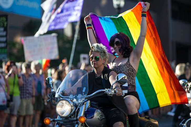 Dykes on Bikes prepare for their ride for the Dyke March during PrideFest Capitol Hill on Saturday, June 24, 2017. (GRANT HINDSLEY, seattlepi.com)
