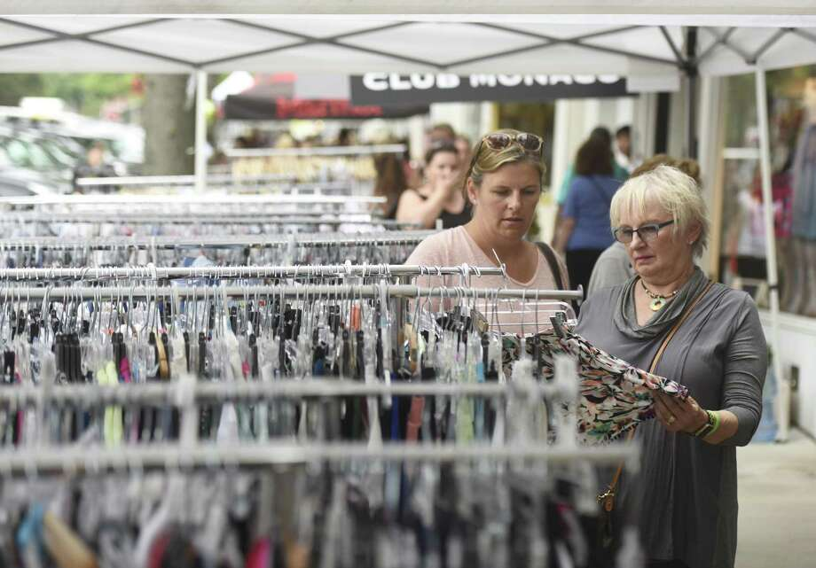 Greenwich resident Kirsten Hennigan, left, and her mother, Char Zola, shop at Hoagland's during opening day of the 2017 Sidewalk Sale Days on Greenwich Avenue in Greenwich, Conn. Thursday, July 13, 2017. Photo: File / Tyler Sizemore / Hearst Connecticut Media / Greenwich Time